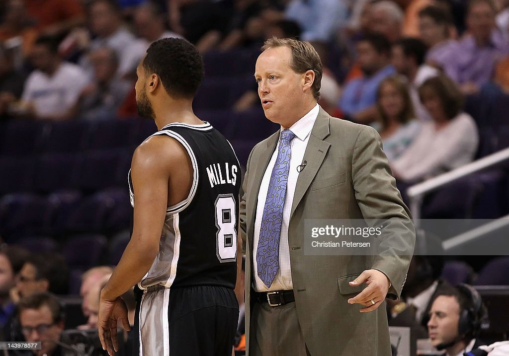 Assistant coach Mike Budenholzer of the San Antonio Spurs during the NBA game against the Phoenix Suns at US Airways Center on April 25, 2012 in Phoenix, Arizona. The Spurs defeated the Suns 110-106.