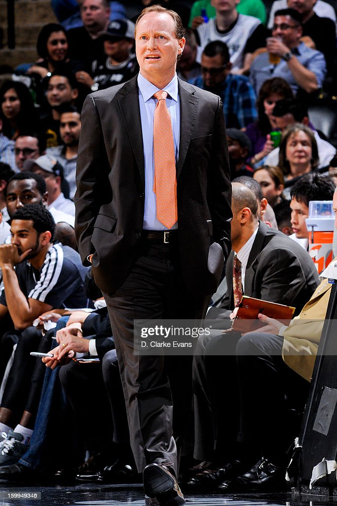 Assistant coach Mike Budenholzer of the San Antonio Spurs looks on as his team plays the New Orleans Hornets on January 23, 2013 at the AT&T Center in San Antonio, Texas.