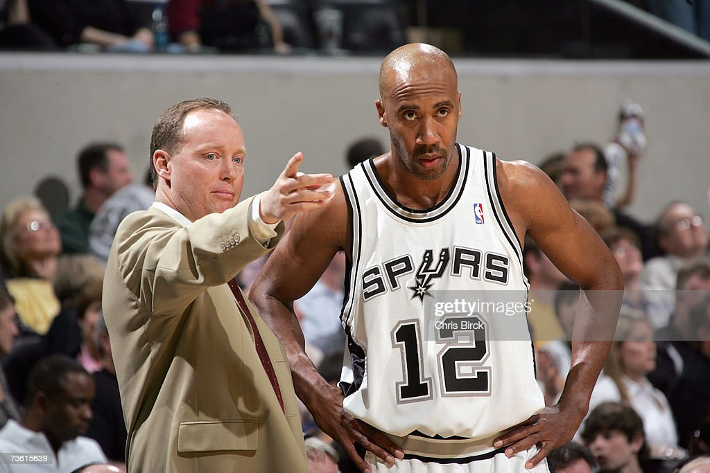 Assistant coach Mike Budenholzer talks with Bruce Bowen #12 of the San Antonio Spurs during the NBA game against the Orlando Magic at AT&T Center on March 2, 2007 in San Antonio, Texas. The Spurs won 98-74.