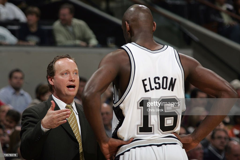 Assistant coach Mike Budenholzer talks with Francisco Elson #16 of of the San Antonio Spurs during the NBA game against the Denver Nuggets on February 20, 2007 at AT&T Center in San Antonio, Texas. The Spurs won 95-80.