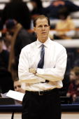 Assistant coach Mike Hopkins of the Syracuse University Orange during drills prior to a game on December 9 2006 against the Colgate University Red...