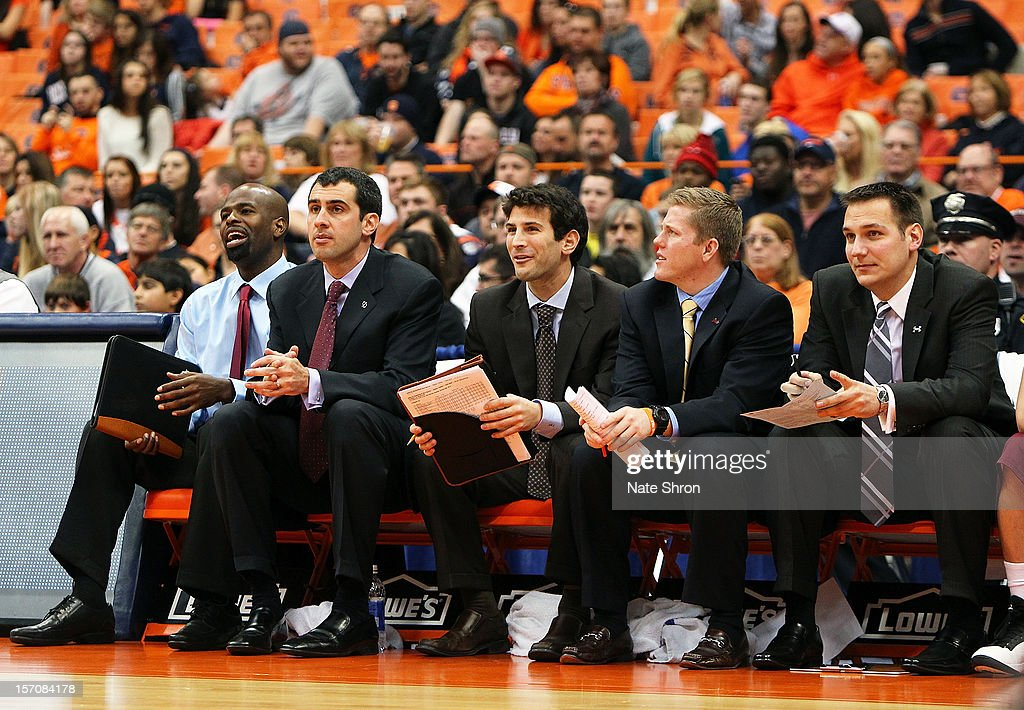 Assistant coach Mike Jordan, head coach Matt Langel, assistant coach Dave Klatsky, assistant coach Michael McGarvey and director of basketball operations Mark Linebaugh look on while sitting on the bench during the game against the Syracuse Orange at the Carrier Dome on November 25, 2012 in Syracuse, New York.