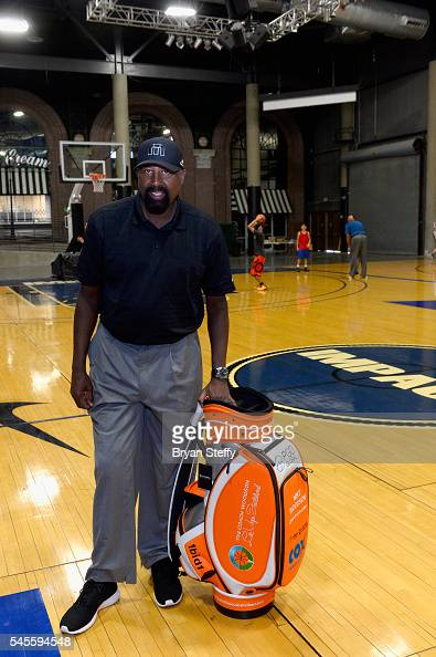 Assistant Coach Mike Woodson of the Los Angeles Clippers is presented a golf bag as he conducts the Woodson Basketball Youth Experience an official...
