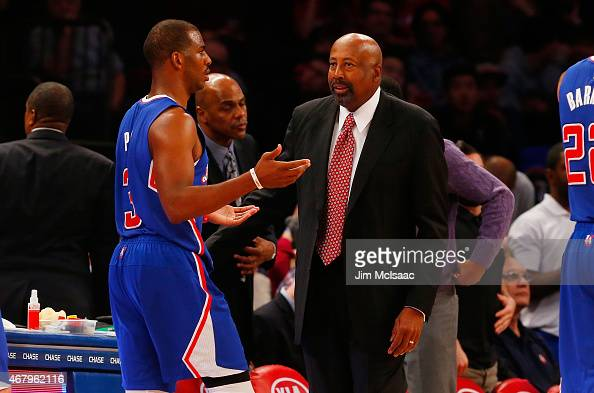 Assistant coach Mike Woodson talks with with Chris Paul of the Los Angeles Clippers during a timeout against the New York Knicks at Madison Square...