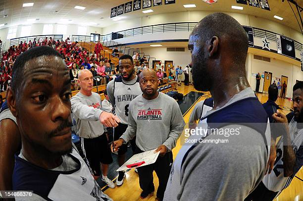 Assistant Coach Nick Van Exel of the Atlanta Hawks gives instructions during a team practice at South Gwinnett High School on October 23 2012 in...