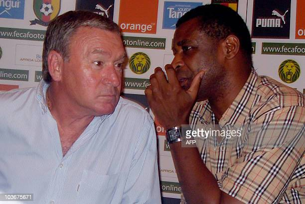 Assistant coach of Cameroon's national team and former footballer Francais Omam Biyick speaks to the team's new coach Javier Clemente of Spain during...