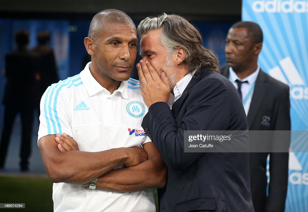 Assistant coach of OM Franck Passi and President of OM Vincent Labrune attend the French Ligue 1 match between Olympique de Marseille (OM) and Troyes ESTAC at New Stade Velodrome on August 23, 2015 in Marseille, France.