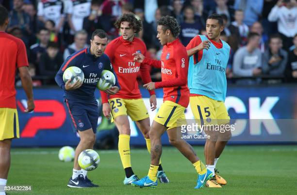 Assistant coach of PSG Juan Carlos Carcedo Adrien Rabiot Neymar Jr and Marquinhos of PSG warm up before the French Ligue 1 match between En Avant...