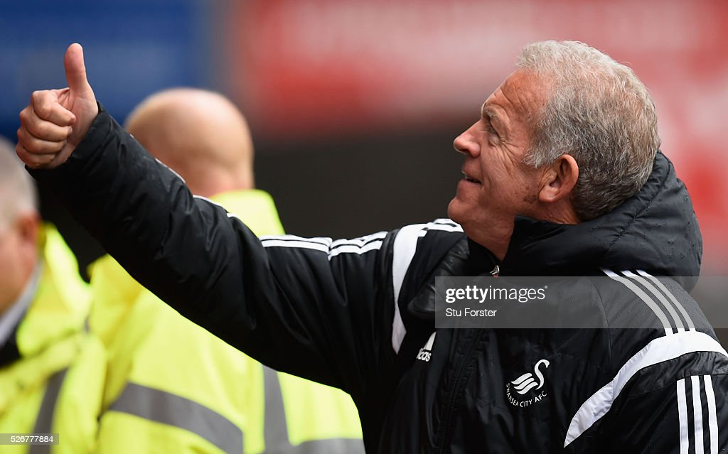 Assistant coach of Swansea Alan Curtis gives the thumbs up as he arrives for the Barclays Premier League match between Swansea City and Liverpool at The Liberty Stadium on May 1, 2016 in Swansea, Wales.