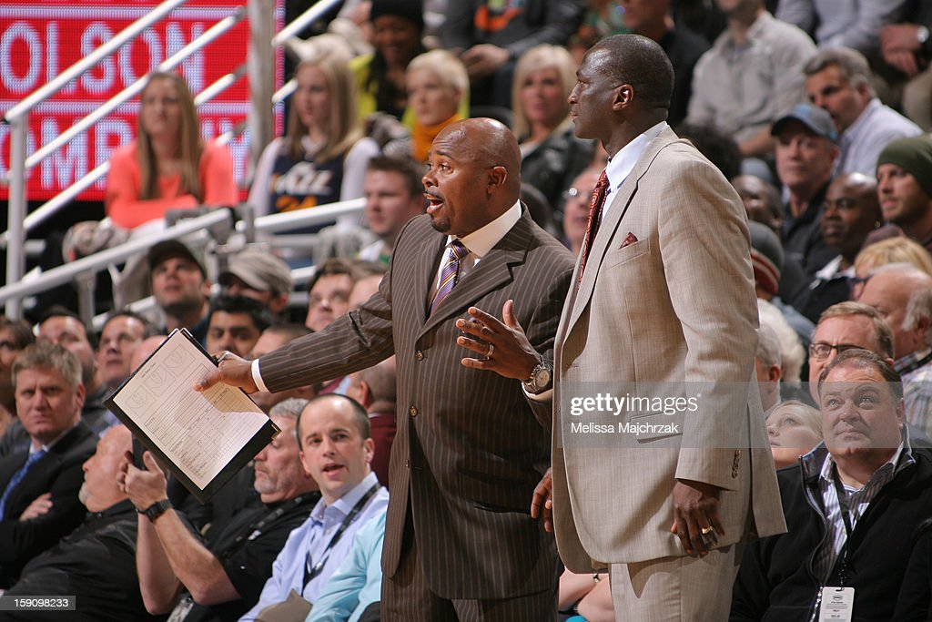Assistant Coach of the Utah Jazz Sidney Lowe and Head Coach Tyrone Corbin respond to a play against the Dallas Mavericks at Energy Solutions Arena on January 7, 2013 in Salt Lake City, Utah.