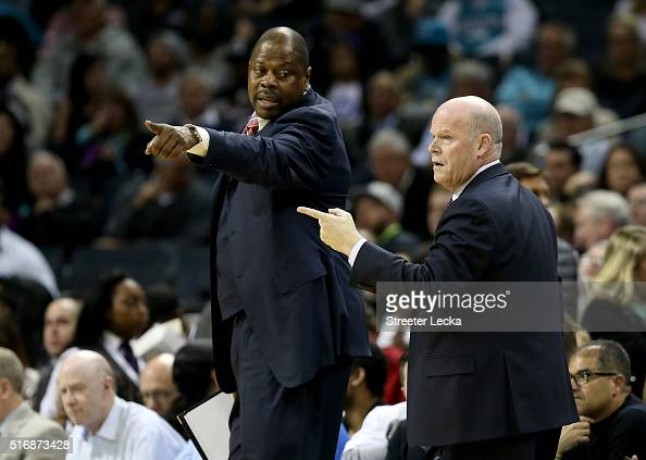 Assistant coach Patrick Ewing and head coach Steve Clifford of the Charlotte Hornets react during their game against the San Antonio Spurs at Time...