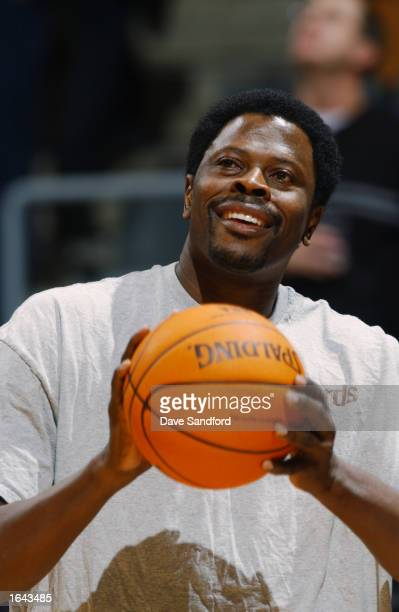 Assistant Coach Patrick Ewing of the Washington Wizards looks to shoot during warmups prior to the NBA game against the Toronto Raptors at the Air...