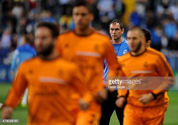 Assistant coach Paul Clement of Real Madrid FC warmsup his players before the La Liga match between Malaga and Real Madrid at La Rosaleda Stadium on...