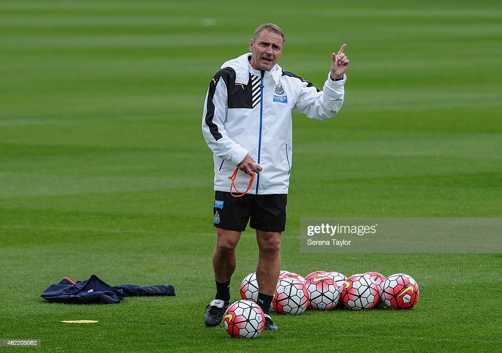 Assistant Coach Paul Simpson stands on the pitch holding one finger in the air with training balls at his feet during the Newcastle United Pre-Season Training session at The Newcastle United Training Centre on July 28, 2015, in Newcastle upon Tyne, England.