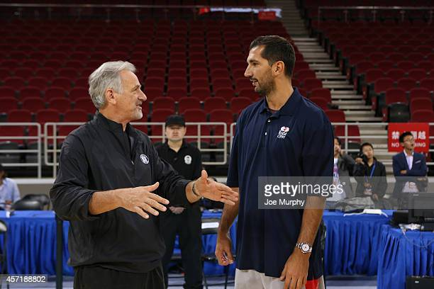 Assistant Coach Paul Westphal of the Brooklyn Nets chats with legend Peja Stojakovic during the NBA Cares Basketball Skills Clinic as part of the...
