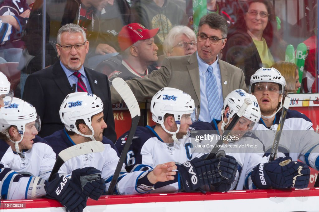 Assistant coach Perry Pearn (L) and head coach Claude Noel (R) of the Winnipeg Jets look on from the bench during an NHL game against the Ottawa Senators at Scotiabank Place on March 17, 2013 in Ottawa, Ontario, Canada.
