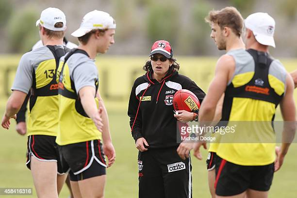 Assistant coach Peta Searle speaks to players during a StKilda Saints AFL training session at Linen House Oval on November 5 2014 in Melbourne...