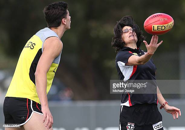 Assistant coach Peta Searle tosses the ball up for Billy Longer during a StKilda Saints AFL training session at Linen House Oval on November 5 2014...