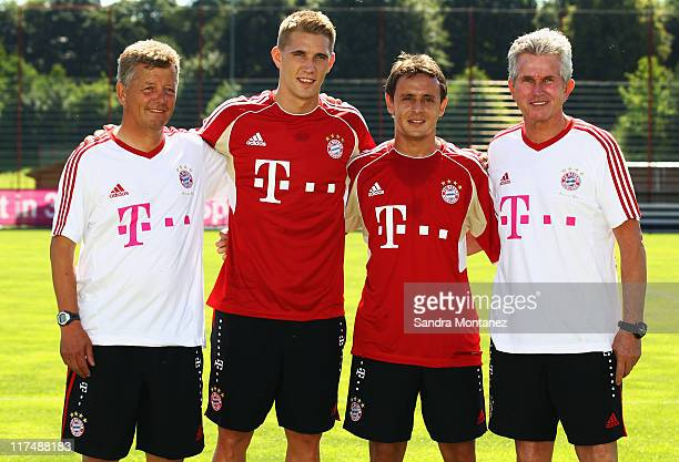 Assistant coach Peter Hermann Nils Pertersen Rafinha and head coach Jupp Heynckes pose during the FC Bayern Muenchen training session at Bayern's...