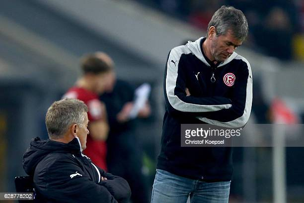 Assistant coach peter Herrmann and head coach Friedhelm Funkel of Duesseldorf look dejected during the Second Bundesliga match between Fortuna...
