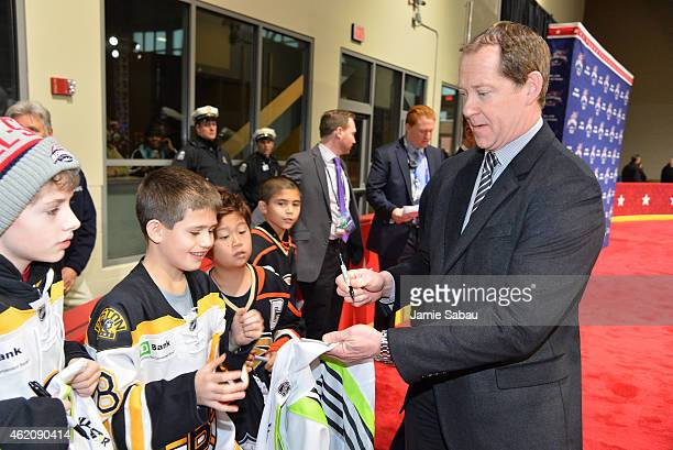 Assistant Coach Phil Housley of the Nashville Predators and Team Toews signs an autograph as he arrives at Nationwide Arena for the 2015 Honda NHL...