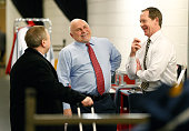 Assistant coach Phil Housley of the Nashville Predators shares a laugh with head coach Barry Trotz and goalie coach Mitch Korn of the Washington...