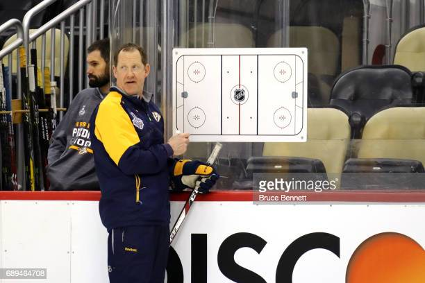 Assistant coach Phil Housley of the Nashville Predators talks in practice during Media Day for the 2017 NHL Stanley Cup Final at PPG PAINTS Arena on...
