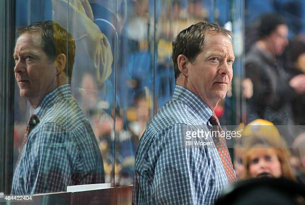 Assistant coach Phil Housley of the Nashville Predators watches warmups before a game against the Buffalo Sabres on February 22 2015 at the First...