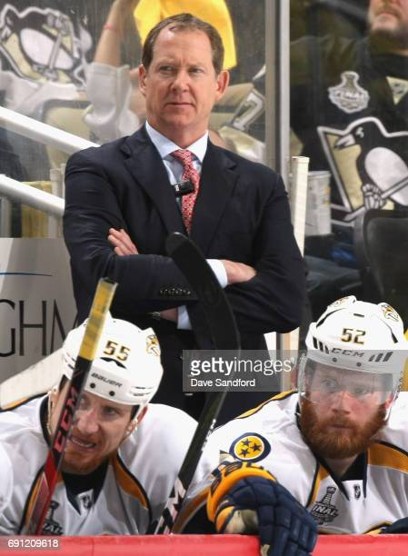 Assistant coach Phil Housley of the Nashville Predators watches from the bench during the third period of Game Two of the 2017 NHL Stanley Cup Final...