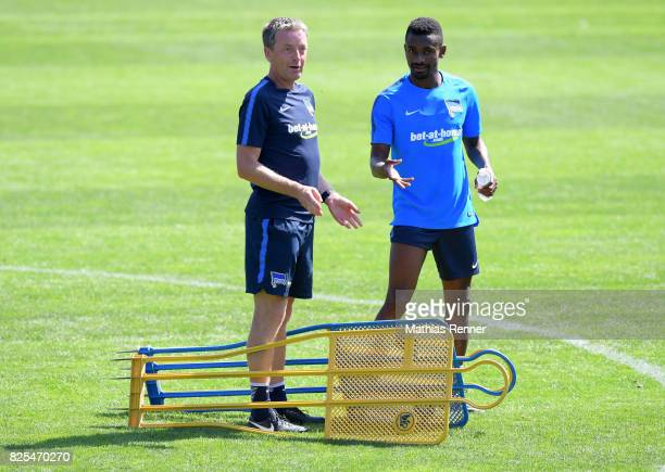 assistant coach Rainer Widmayer and Salomon Kalou of Hertha BSC chat during the training camp on august 2 2017 in Schladming Austria
