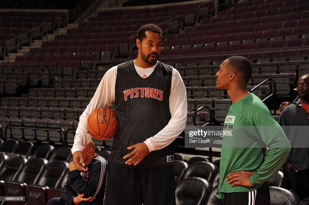 Assistant Coach Rasheed Wallace of the Detroit Pistons speaks to Rajon Rondo #9 of the Boston Celtics during the game on November 3, 2013 at The Palace of Auburn Hills in Auburn Hills, Michigan.