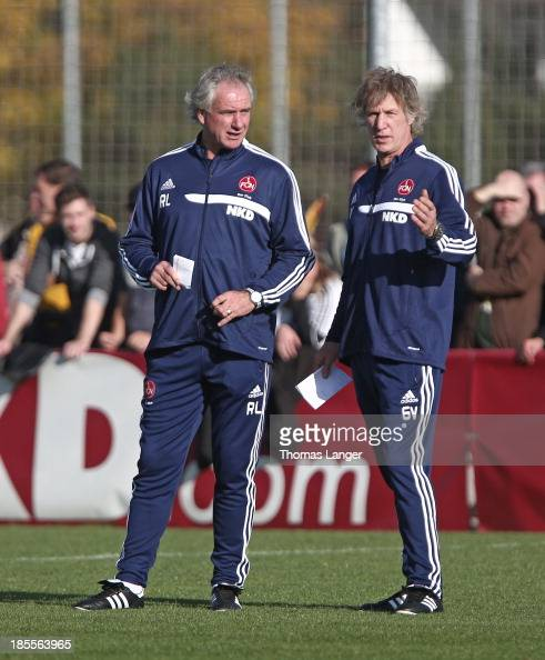 Assistant coach Raymond Libregts and new headcoach Gertjan Verbeek of 1 FC Nuernberg observe a practicing session on October 22 2013 in Nuremberg...