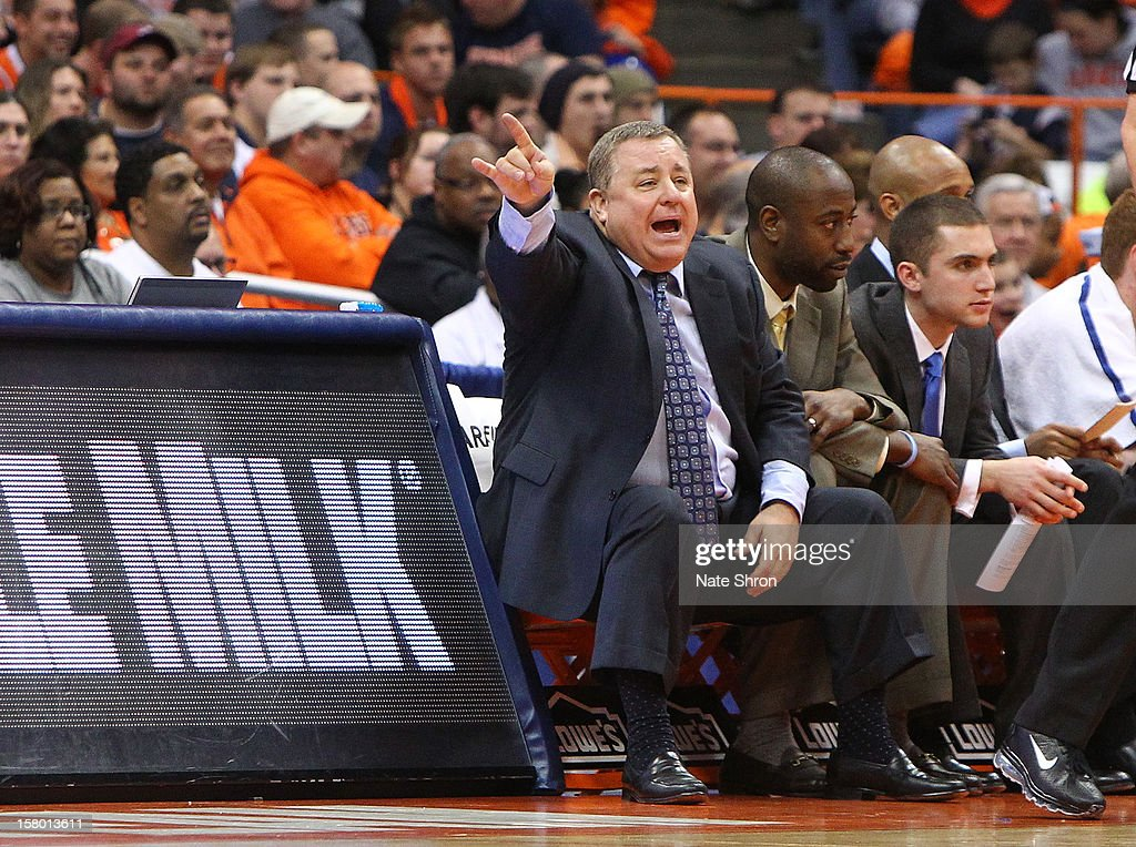 Assistant coach Rick Callahan of the Monmouth Hawks gestures as he sits on the bench during the game against the Syracuse Orange at the Carrier Dome on December 8, 2012 in Syracuse, New York.
