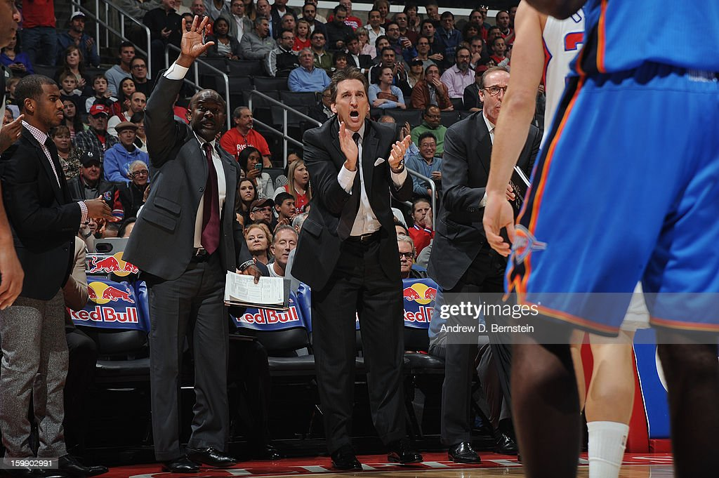 Assistant coach Robert Pack and Head coach Vinny Del Negro of the Los Angeles Clippers cheer on their team against the Oklahoma City Thunder at Staples Center on January 22, 2013 in Los Angeles, California.