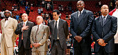 Assistant coach Ron Rothstein head coach Erik Spoelstra assistant coach Bob McAdoo and assistant coach David Fizdale of the Miami Heat stand on the...