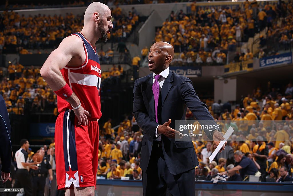 Assistant coach, <a gi-track='captionPersonalityLinkClicked' href=/galleries/search?phrase=Sam+Cassell&family=editorial&specificpeople=201572 ng-click='$event.stopPropagation()'>Sam Cassell</a> talks to <a gi-track='captionPersonalityLinkClicked' href=/galleries/search?phrase=Marcin+Gortat&family=editorial&specificpeople=589986 ng-click='$event.stopPropagation()'>Marcin Gortat</a> #4 of the Washington Wizards during Game One of the Eastern Conference Semifinals against the Indiana Pacers on May 5, 2014 at Bankers Life Fieldhouse in Indianapolis, Indiana.