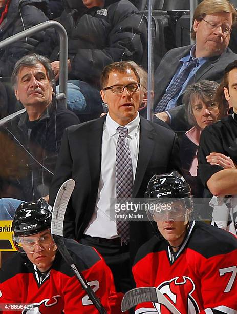 Assistant coach Scott Stevens of the New Jersey Devils looks on during a timeout against the Columbus Blue Jackets at the Prudential Center on...