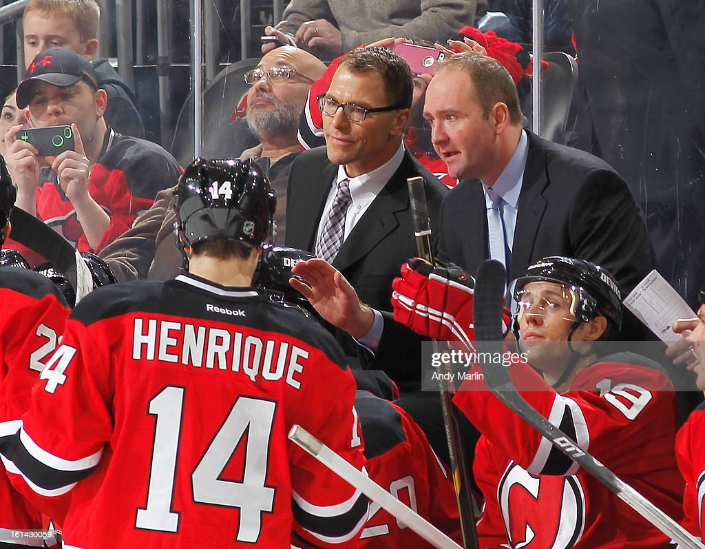 Assistant coach Scott Stevens (L) of the New Jersey Devils looks on as head coach Peter DeBoer gives instructions against the Pittsburgh Penguins during the game at the Prudential Center on February 9, 2013 in Newark, New Jersey.