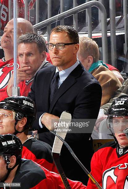 Assistant coach Scott Stevens of the New Jersey Devils looks on against the Boston Bruins during the game at the Prudential Center on April 10 2013...
