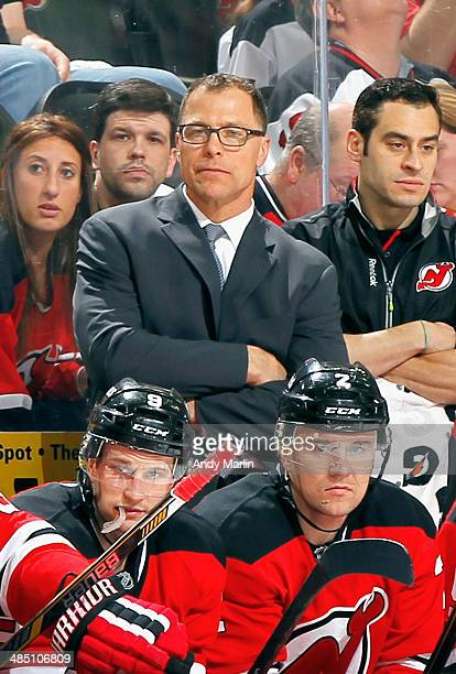 Assistant coach Scott Stevens of the New Jersey Devils looks on during the game against the Boston Bruins at the Prudential Center on April 13 2014...