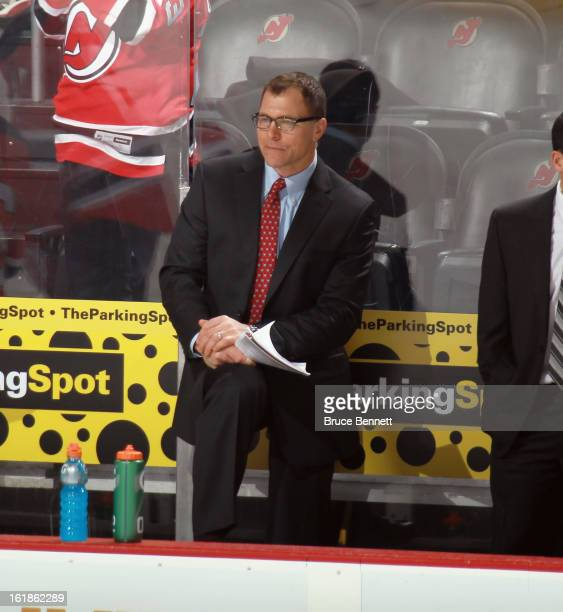 Assistant coach Scott Stevens of the New Jersey Devils watches practice prior to the game against the Philadelphia Flyers at the Prudential Center on...