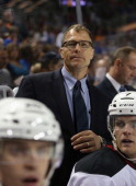 Assistant coach Scott Stevens works the bench against the New York Islanders during a preseason game at the Barclays Center on September 21 2013 in...