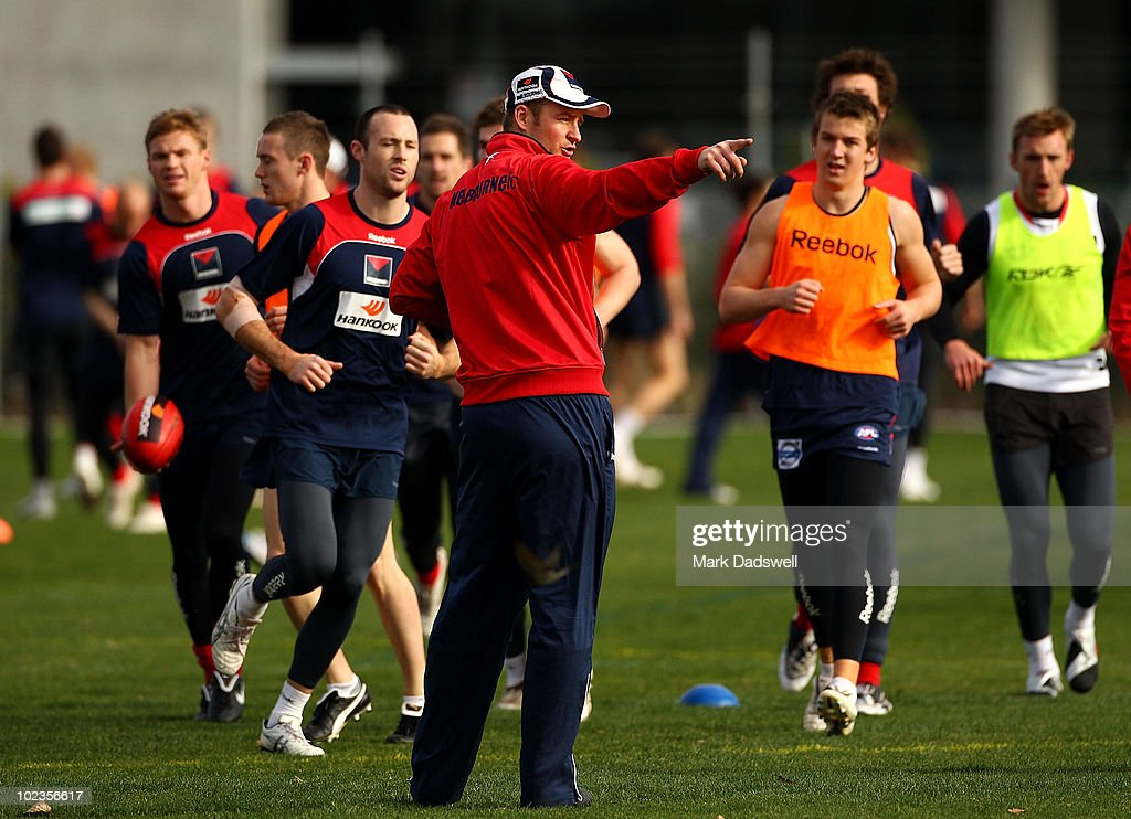 Assistant Coach Sean Wellman instructs players during a Melbourne Demons AFL training session at their new training oval adjacent to AAMI Park on...