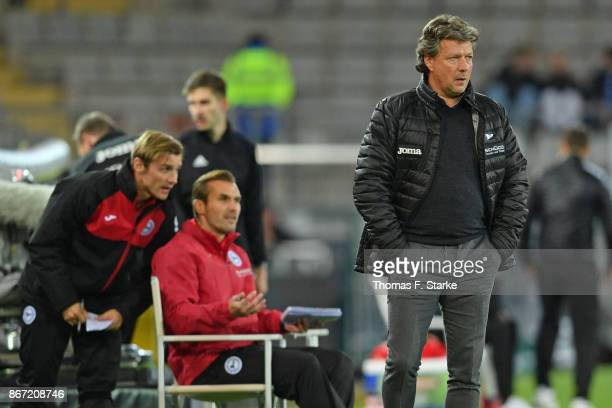 Assistant coach Sebastian Hille assistant coach Carsten Rump and head coach Jeff Saibene of Bielefeld look on during the Second Bundesliga match...