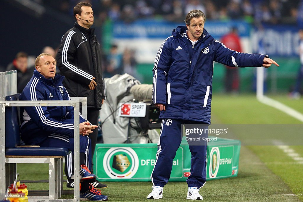 Assistant coach Seppo Eichkorn and head coach Jens Keller of Schalke issues instructions during the DFB cup round of sixteen match between FC Schalke 04 and FSV Mainz 05 at Veltins-Arena on December 18, 2012 in Gelsenkirchen, Germany.