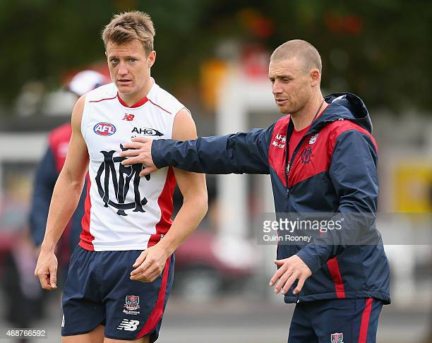 Assistant coach Simon Goodwin gives instructions to Aaron Vandenberg of the Demons during a Melbourne Demons AFL training session at AAMI Park on...