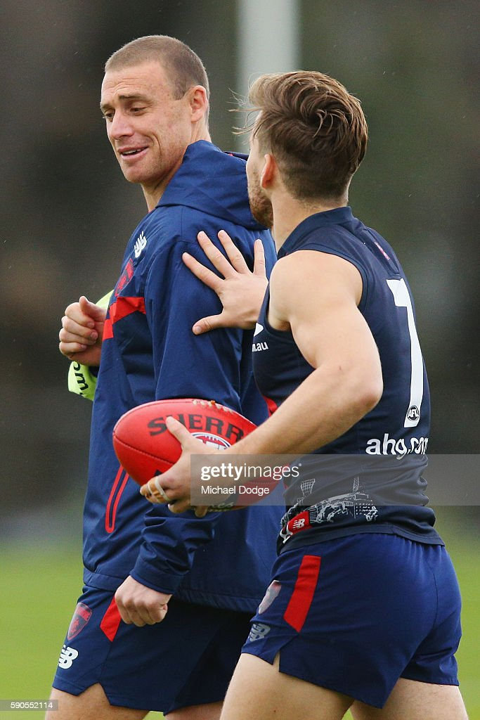 Assistant coach Simon Goodwin who will be head coach next season is pushed by Jack Viney during a Melbourne Demons AFL training session at AAMI Park...