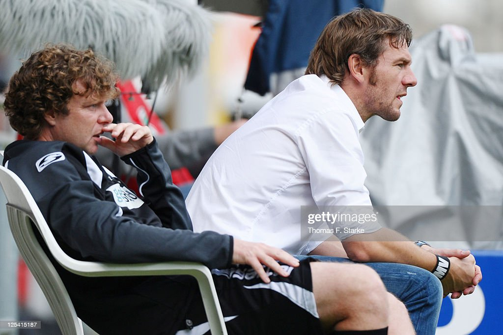 Assistant coach Stefan Kraemer (L) and head coach Markus von Ahlen of Bielefeld look dejected during the Third League match between Arminia Bielefeld and 1. FC Saarbruecken at the Schueco Arena on September 17, 2011 in Bielefeld, Germany.