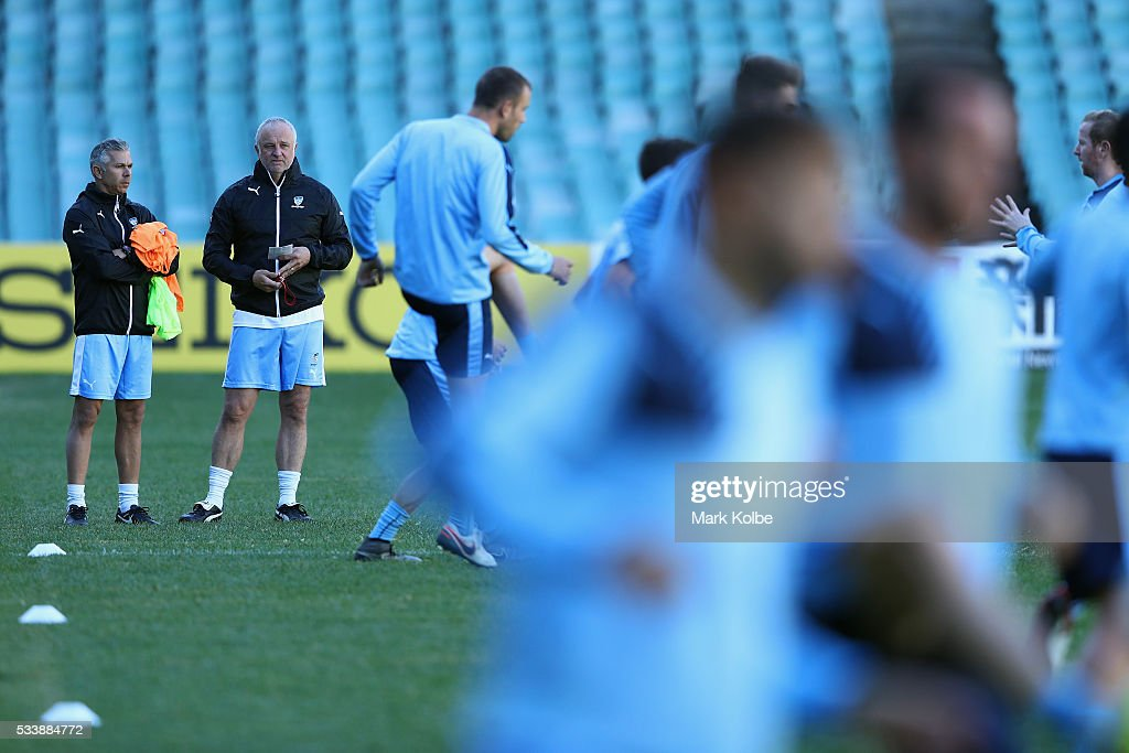 Assistant coach Steve Corica speaks to Sydney FC coach Graham Arnold during a Sydney FC training session at Allianz Stadium on May 24, 2016 in Sydney, Australia.