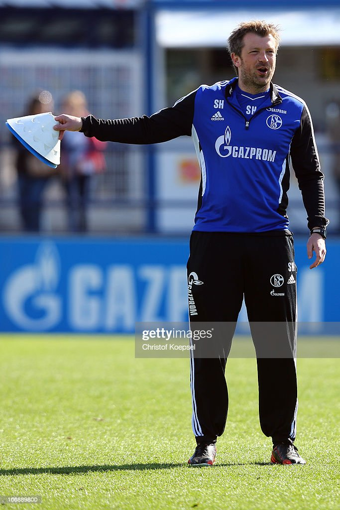 Assistant coach Sven Huebscher issues instructions during the FC Schalke 04 training session at their training ground on April 18, 2013 in Gelsenkirchen, Germany.